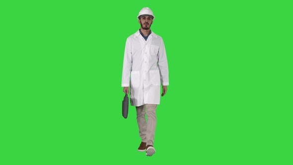 Thumbnail for Professional Engineer with Suitcase and in Helmet Walking on a Green Screen, Chroma Key
