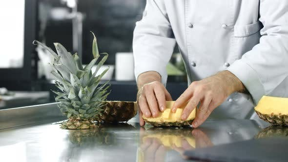 Thumbnail for Chef Cutting Pineapple at Kitchen. Closeup Chef Hands Chopping Healthy Fruit