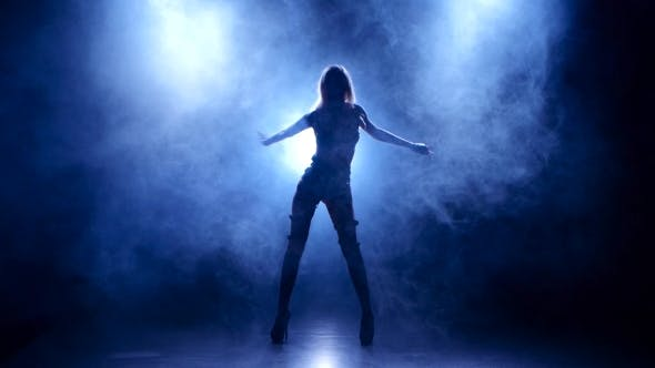Thumbnail for Slender Blonde in Leather Lingerie Dances. Silhouette on Smoky Background