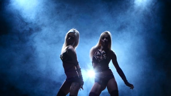 Thumbnail for Two Blondes Gogo Dancers Posing in Studio on Smoke Background