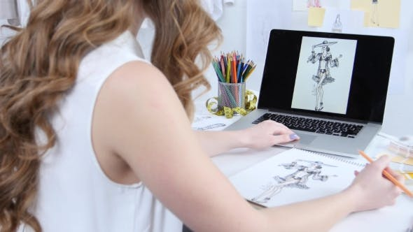 Thumbnail for Artist in His Office, Draw a Sketch of a New Outfit for Girls