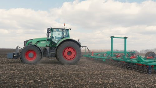 Agrobusiness - Tractor Running in the Field
