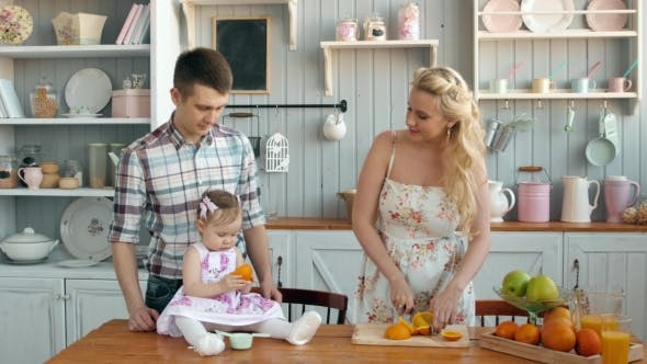 Thumbnail for Family Eating Healthy Breakfast in Kitchen, Happy Family Mom Mother and Dad Father with Little Girl