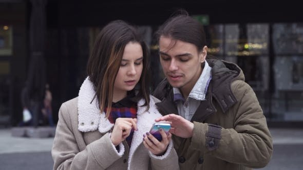 Thumbnail for Young Couple with Smartphone
