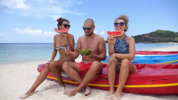 Thumbnail for Two Women and Handsome Man Having Fun on Beach