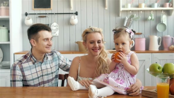 Thumbnail for Mother Father and Daughter Cooking Dinner in Kitchen, Happy Family, Mom Dad and Child Girl Morning