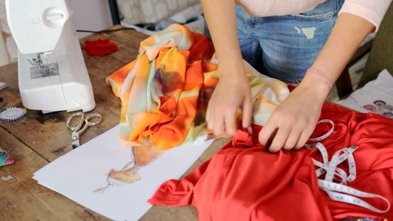 Thumbnail for Crop Seamstress Choosing Fabric for Dress