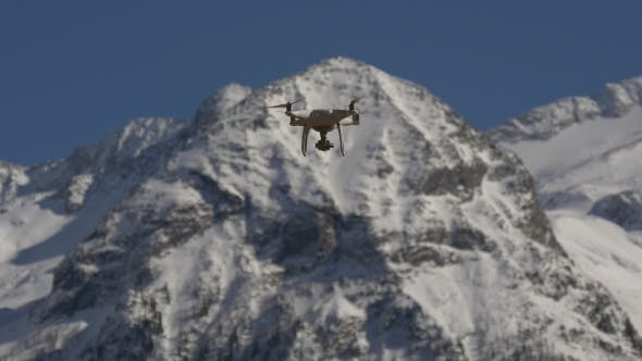 Thumbnail for Drone on a Background of Snow-capped Peaks