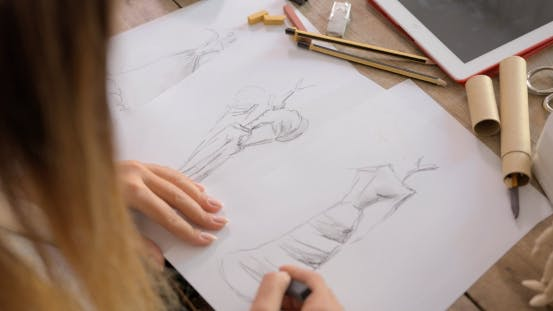 Thumbnail for Crop Shot of Dressmaker Drawing Sketches