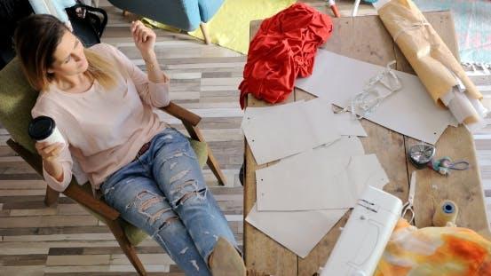 Thumbnail for Female Tailor Having Rest in Workshop