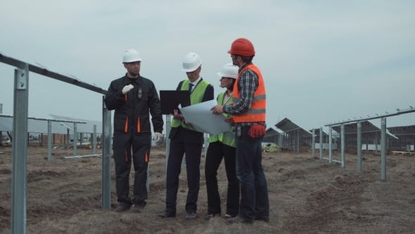 Thumbnail for Supervisors with Blueprint at Solar Panels