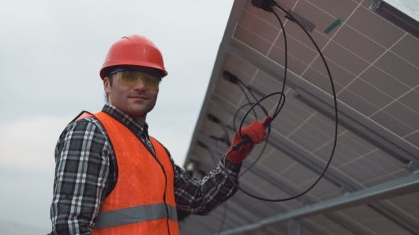 Thumbnail for Worker Mounting Solar Panels