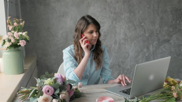 Thumbnail for Female Florist Talking on Mobile Phone