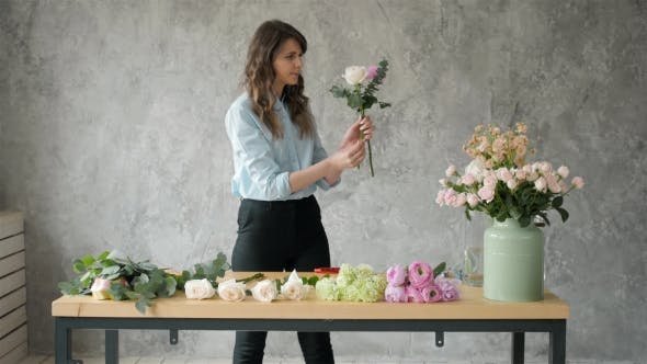 Thumbnail for People, Business, Sale and Floristry Concept - Happy Smiling Florist Woman Making Bunch at Flower