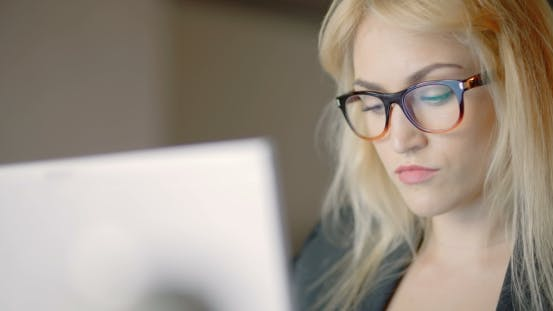 Thumbnail for Businesswoman Wearing Eyeglasses While Using Laptop In Office