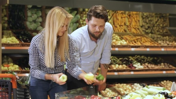 Thumbnail for Couple Choose Bell Peppers at the Supermarket