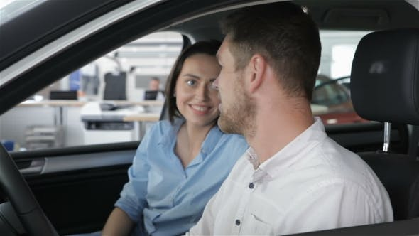 Thumbnail for Couple Talks Inside the Car at the Dealership