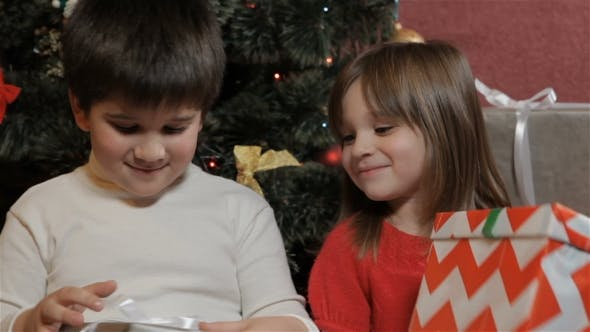 Thumbnail for Kids Look at Their Christmas Gifts