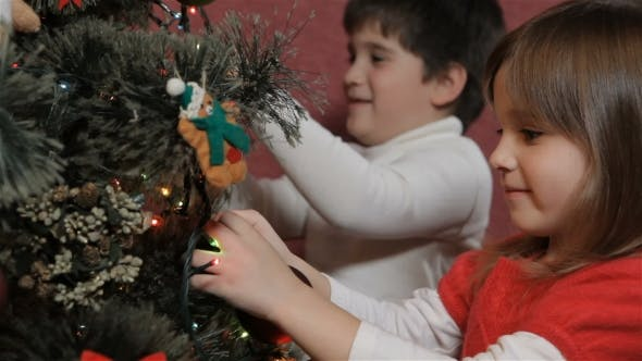 Thumbnail for Children Decorate the Christmas Tree