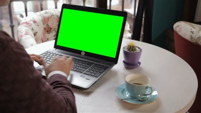 Man Looks at the Laptop Screen