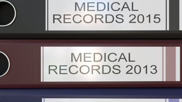 Thumbnail for Vertical Stack of Multicolor Office Binders with Medical Records Tags Different Years