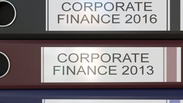 Thumbnail for Vertical Stack of Multicolor Office Binders with Corporate Finance Tags Different Years