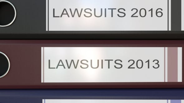 Thumbnail for Vertical Stack of Multicolor Office Binders with Lawsuits Tags Different Years