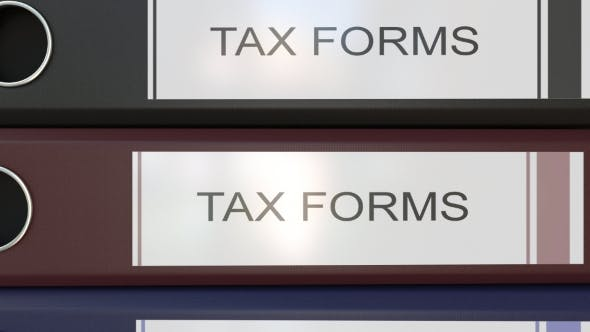 Thumbnail for Vertical Stack of Multicolor Office Binders with Tax Forms Tags