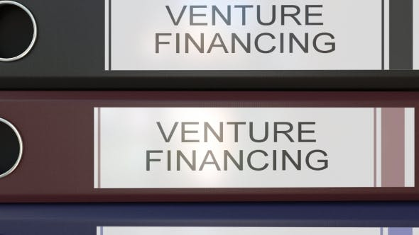 Thumbnail for Vertical Stack of Multicolor Office Binders with Venture Financing Tags