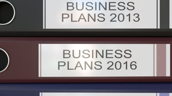 Thumbnail for Vertical Stack of Multicolor Office Binders with Business Plans Tags Different Years