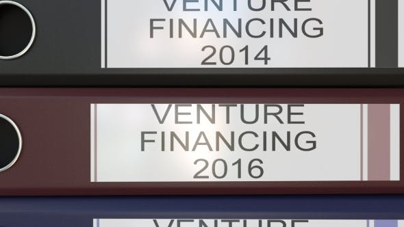 Thumbnail for Vertical Stack of Multicolor Office Binders with Venture Financing Tags Different Years