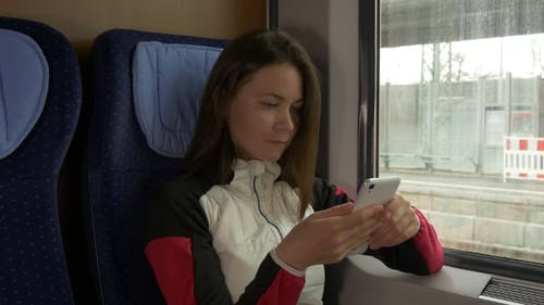 Departing Train and the Woman with the Phone