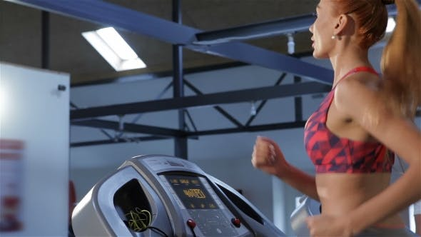 Thumbnail for Woman Increases the Speed of Treadmill at the Fitness Centre