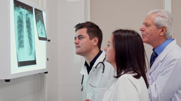 Thumbnail for Medical Team Analizes X-ray on X-ray View Box