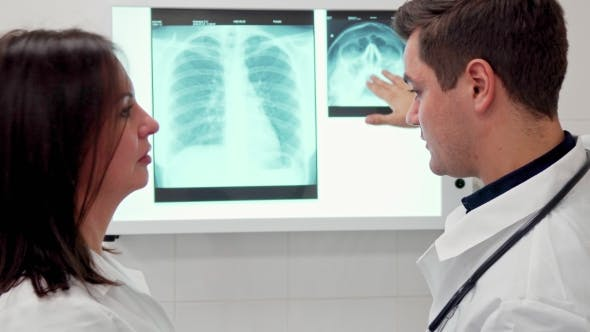 Thumbnail for Male Doctor Explaines Something on X-ray To His Female Colleague