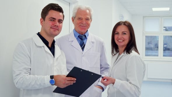 Thumbnail for Male Doctor Holding Clipboard in His Hand