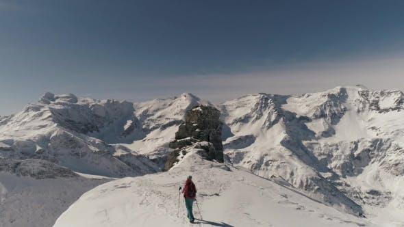Thumbnail for Female Trakker Reaching Top of Snowy Mountain