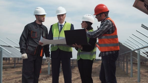 Thumbnail for Engineers Workers with Blueprints at Solar Farm