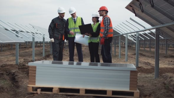 Thumbnail for Engineers with Blueprint and Laptop on Solar Farm