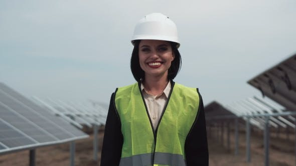 Cover Image for Woman in Hardhat Looking Camera