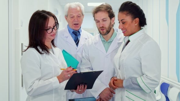 Thumbnail for Medical Team Looks at Clipboard
