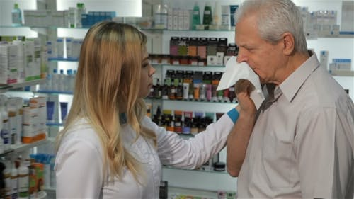 Female Pharmacist Offers Remedy for Cough To the Customer