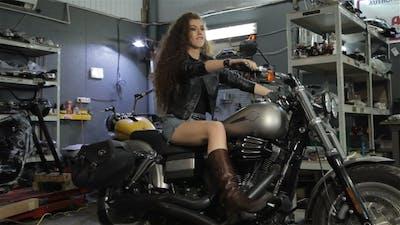 Female Biker Sits on the Chopper