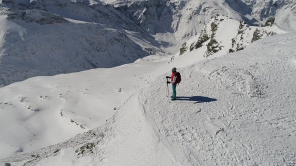 Thumbnail for Aerial View of Female Hiker on Top of Mountain