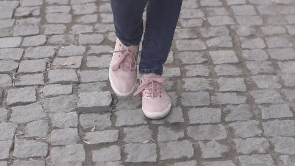 Thumbnail for Girls Feet in Sneakers Walking on the Sidewalk
