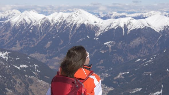 Woman Enjoies the View of Mountain Summits