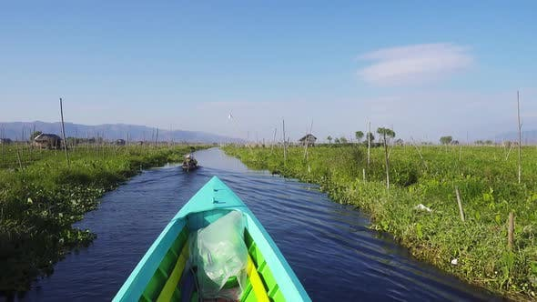 Thumbnail for Boat Floats Among Floating Gardens on Inle Lake