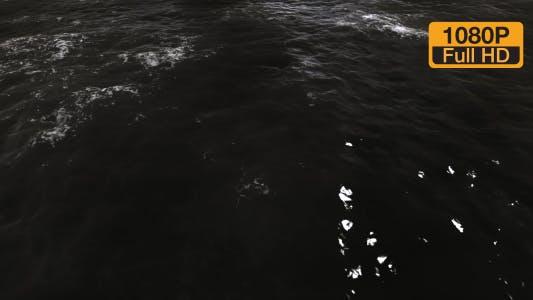 Thumbnail for Dark black wavy water surface