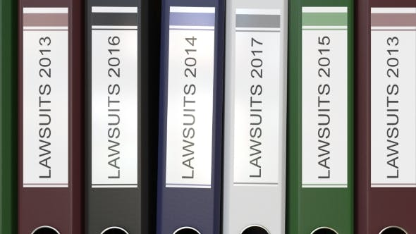 Thumbnail for Multiple Office Folders with Lawsuits Text Labels Different Years