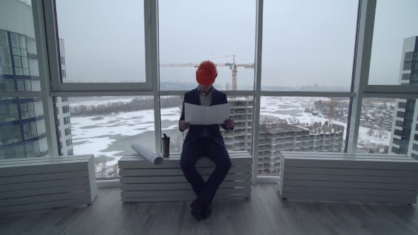 Thumbnail for Manager in Construction Company Looking on Plan New Building.